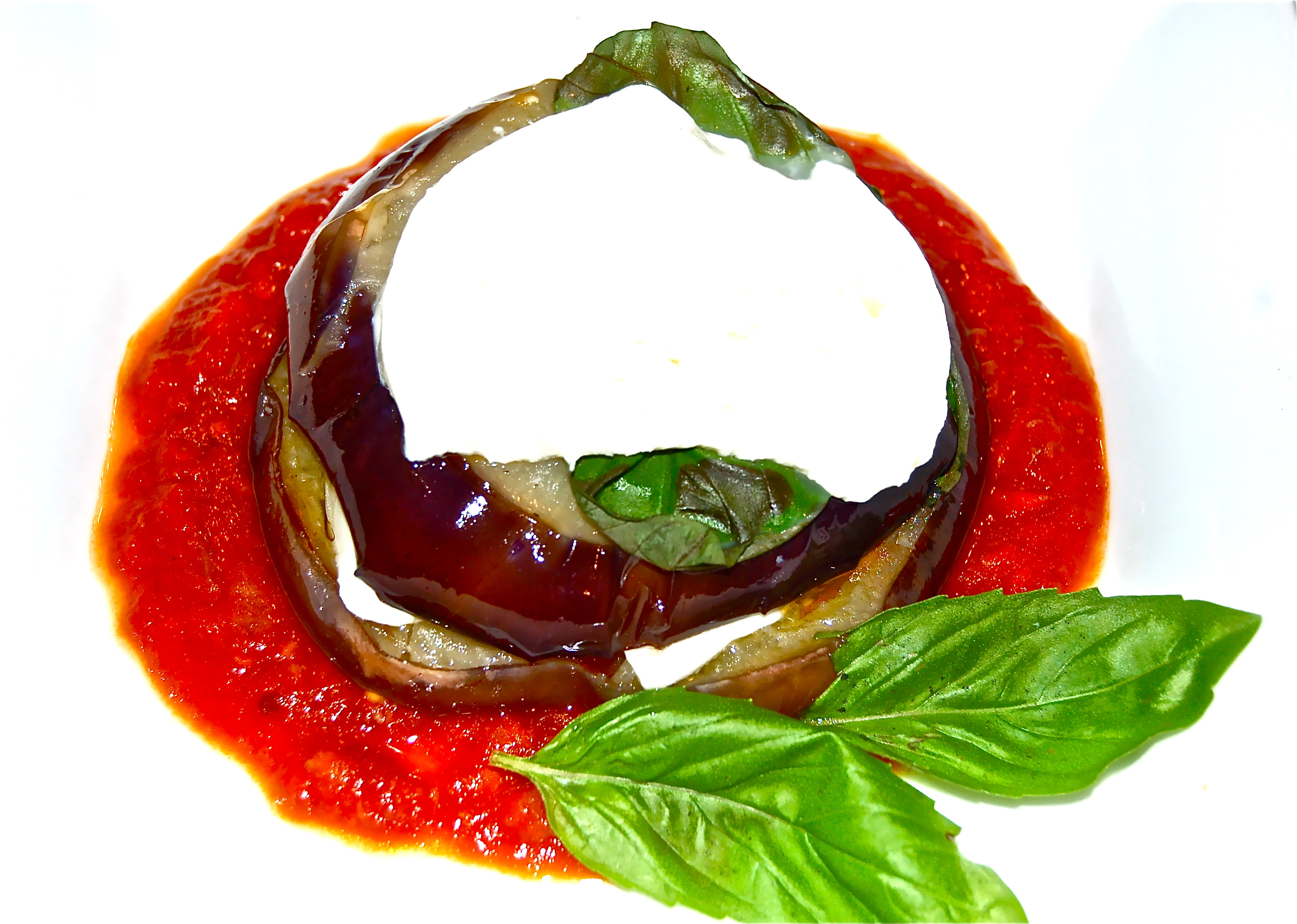 A Napoleon of Roasted Eggplant, Mozzarella, Basil Leaves  Tomato